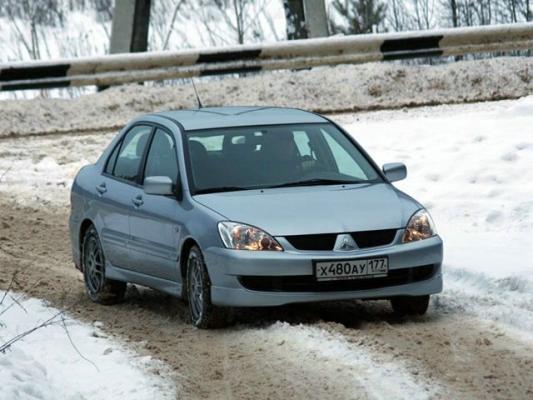 Два литра с верхом / Тест-драйв Mitsubishi Lancer и Mazda 3